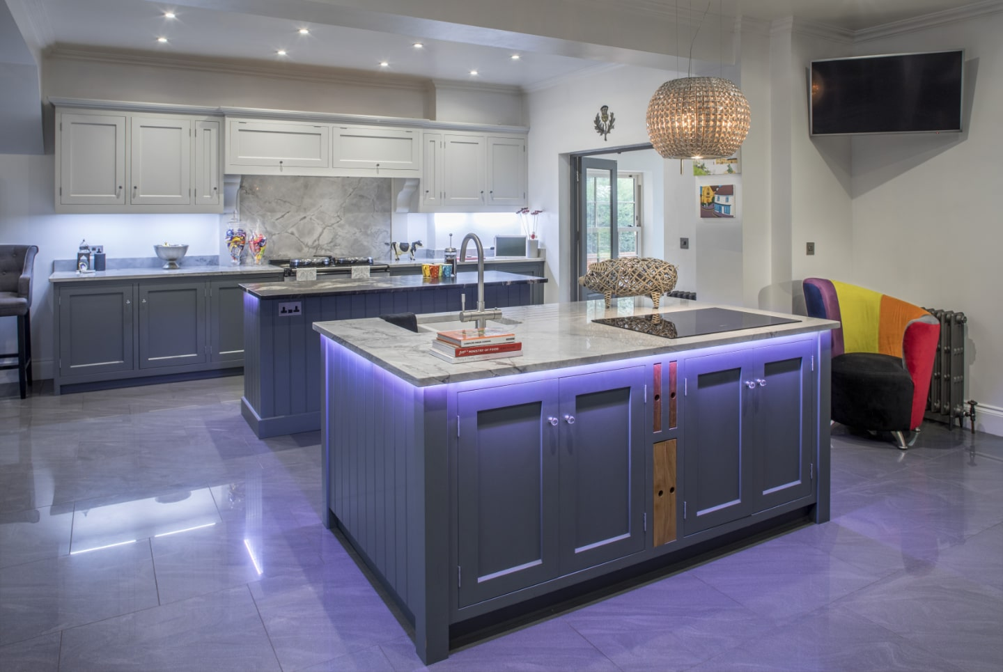 A bespoke kitchen with custom LED lighting under the work tops.