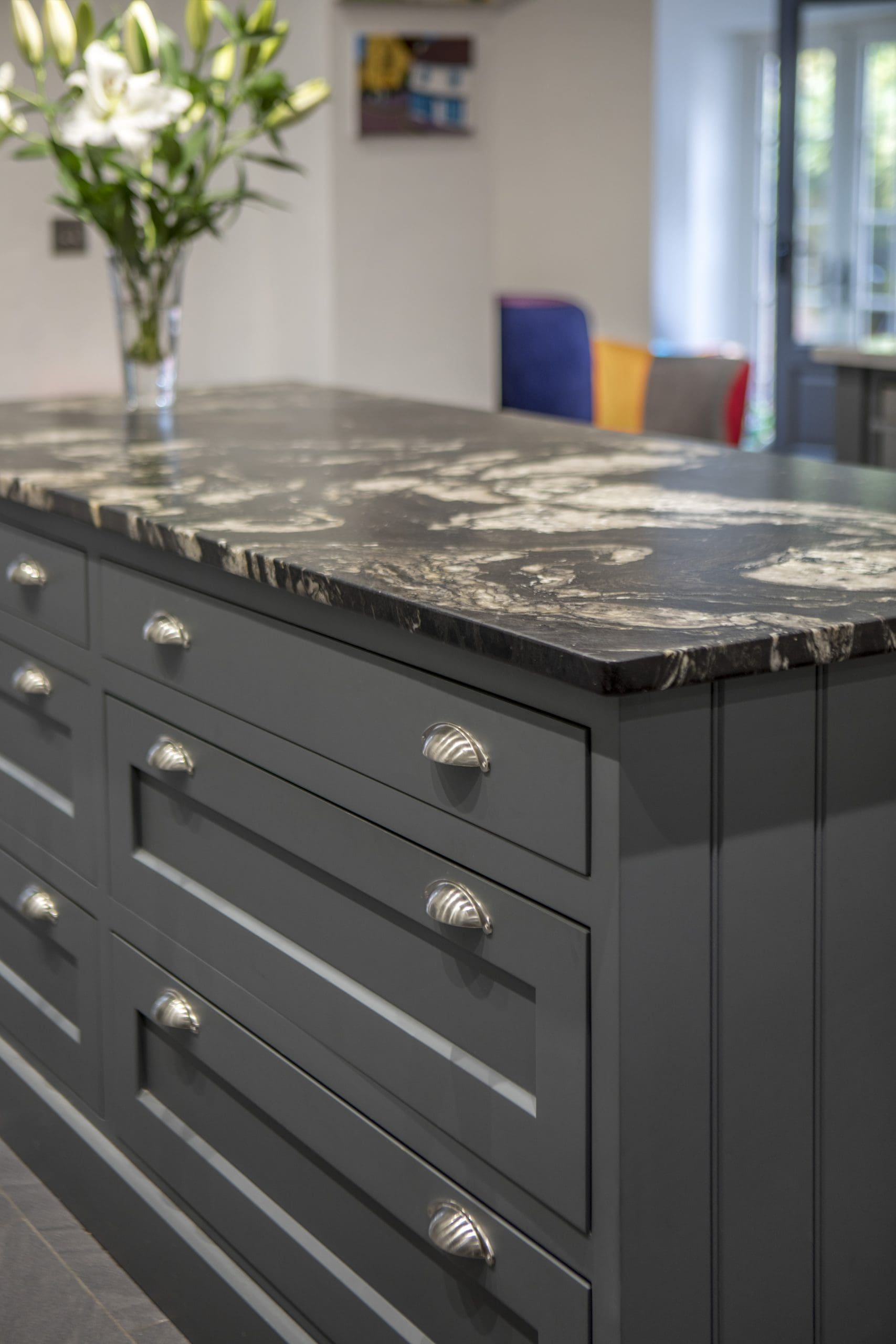 A bespoke kitchen island with a marble work top.