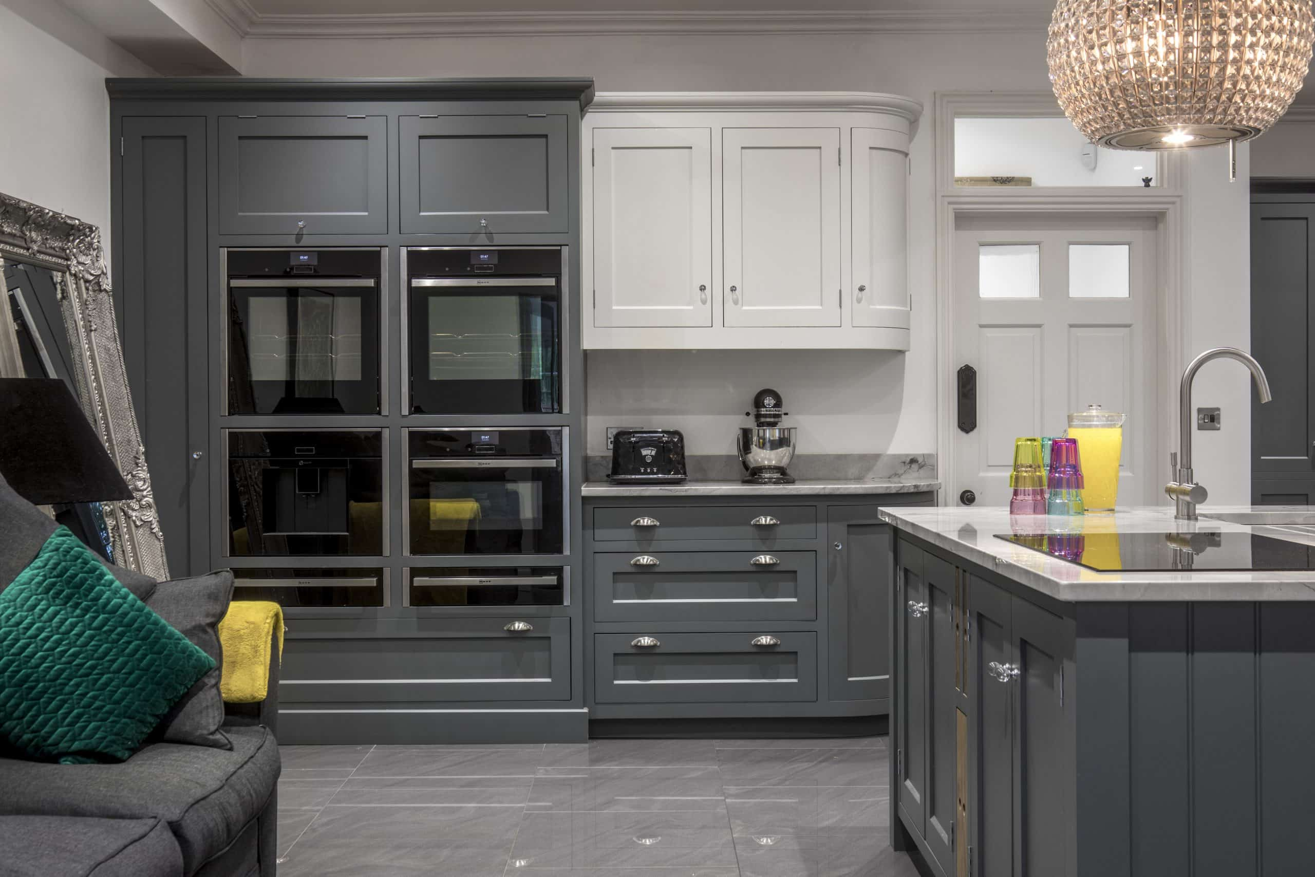 A beautiful, bespoke kitchen with a marble floor