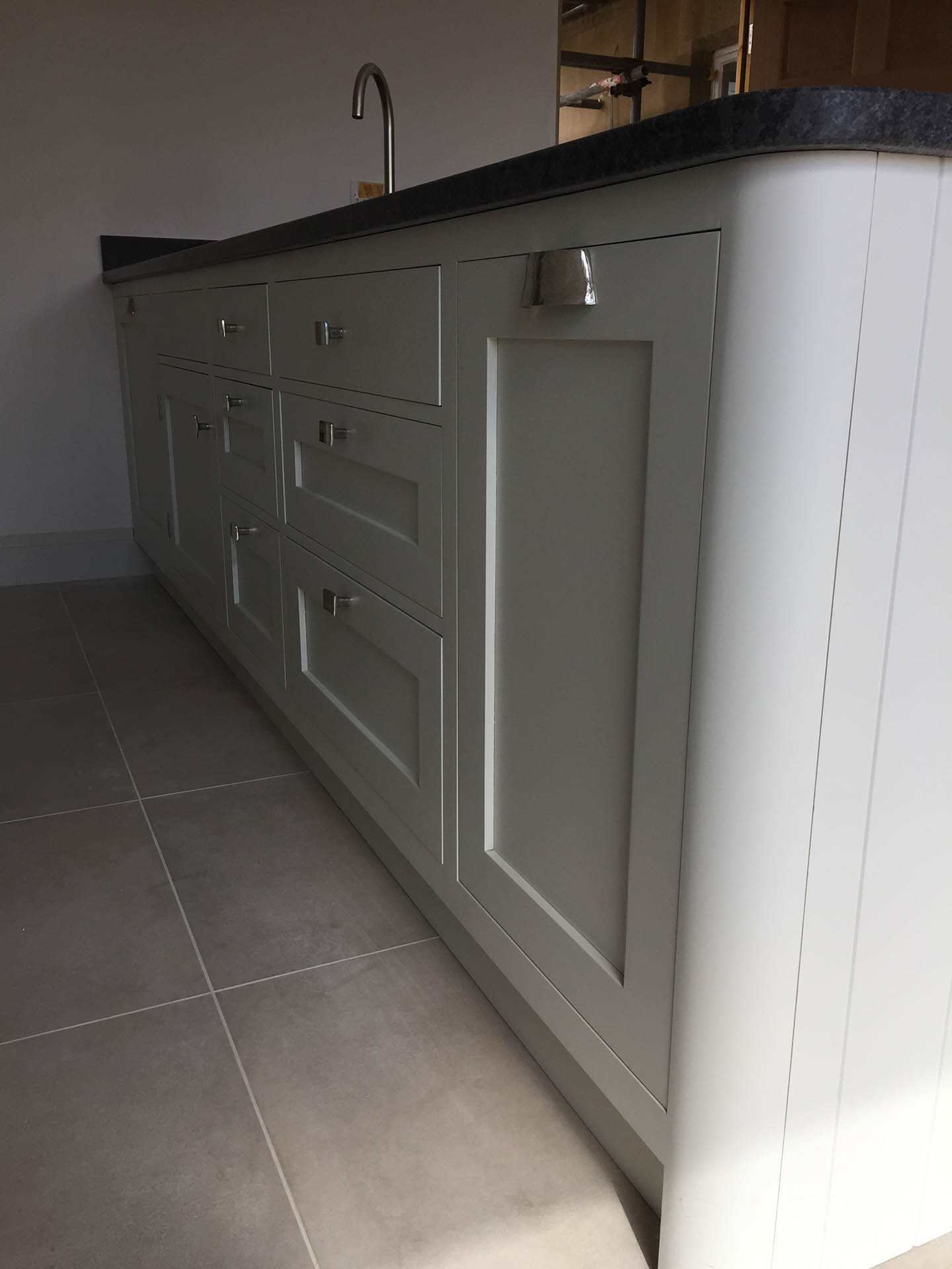 The cupboard doors of a kitchen counter,