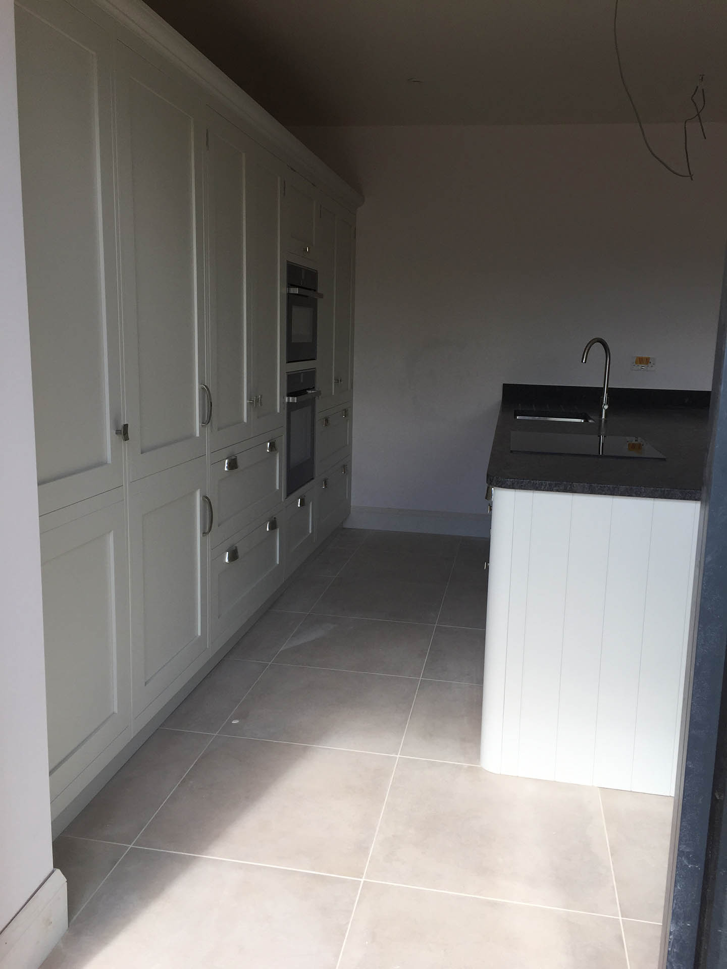 A view of one side of the kitchen showing cupboards