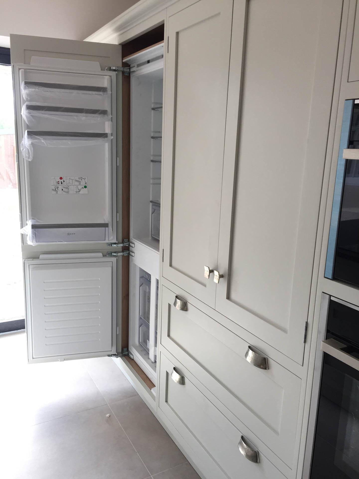 A kitchen fridge with bespoke facade.