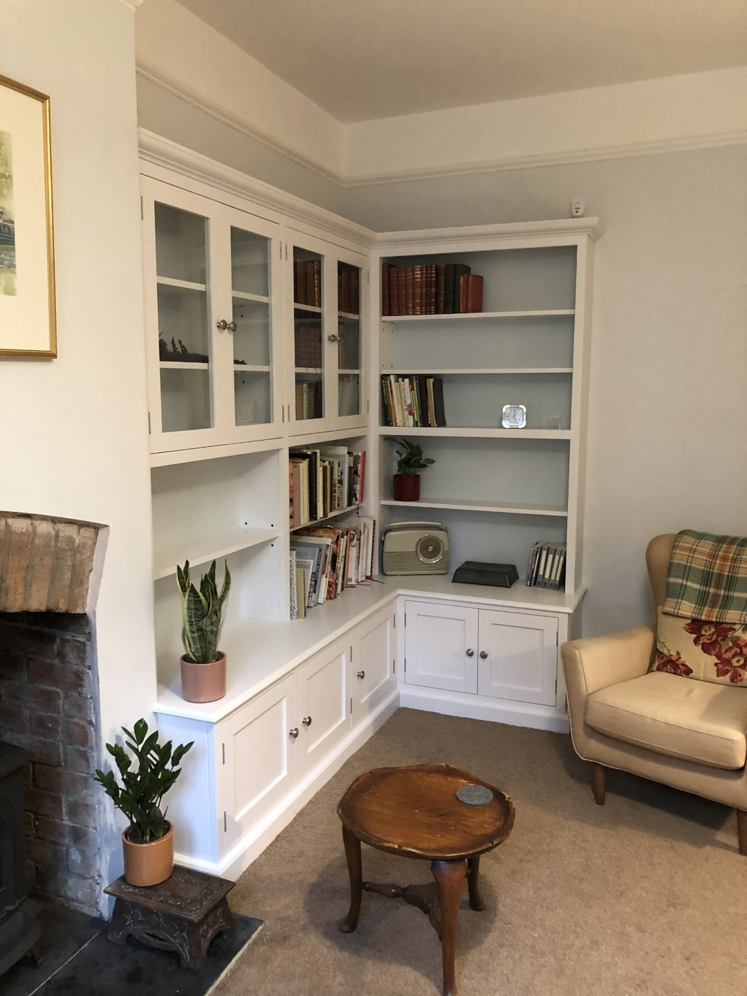 A bespoke bookcase nestled in the corner of a cozy room.