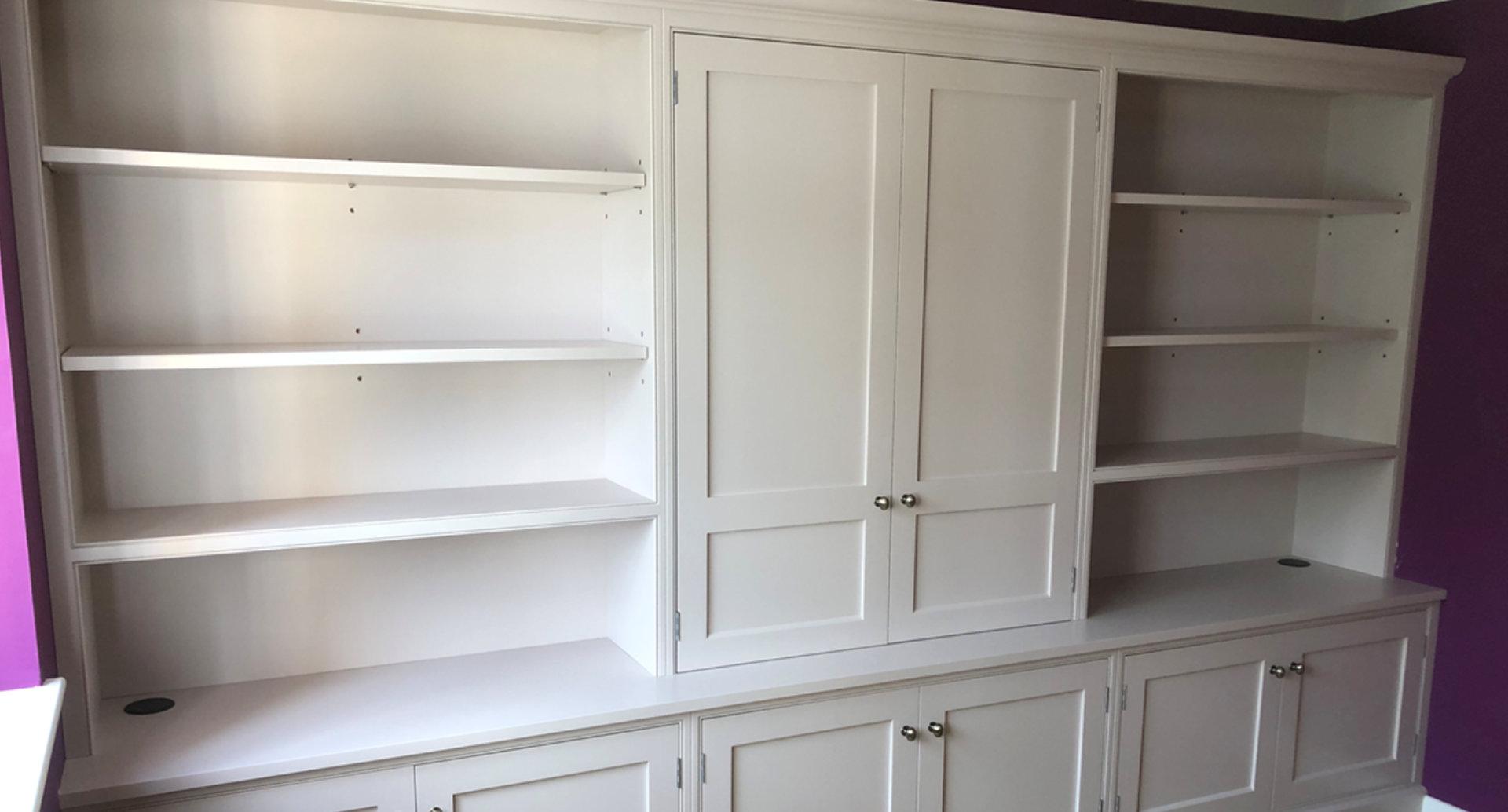 A beautiful, full width, bespoke bookcase.