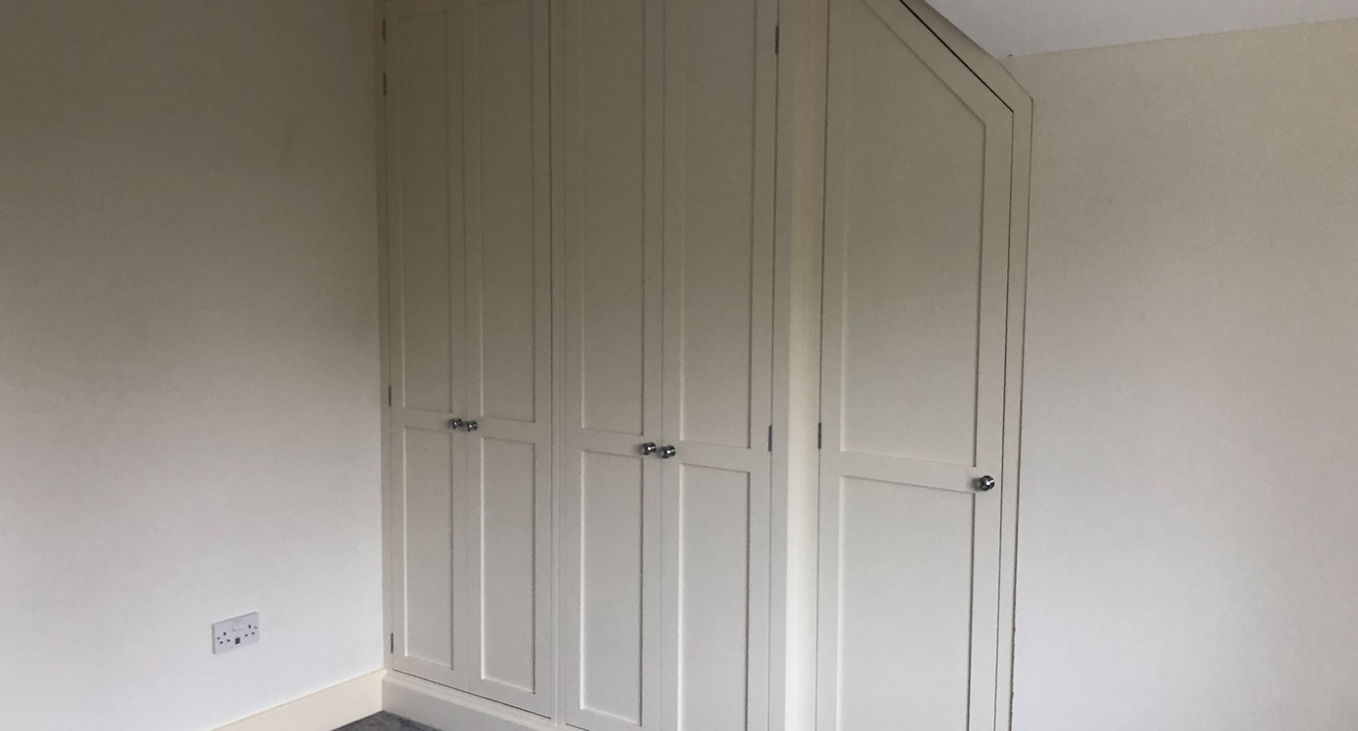 A fully integrated, wooden wardrobe.