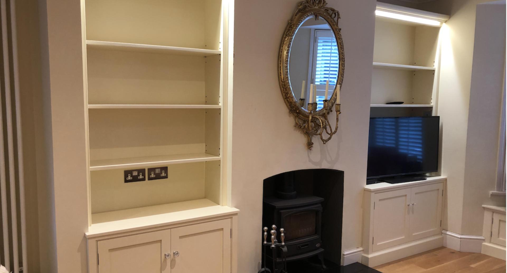 Two custom, bespoke bookcases with custom lighting