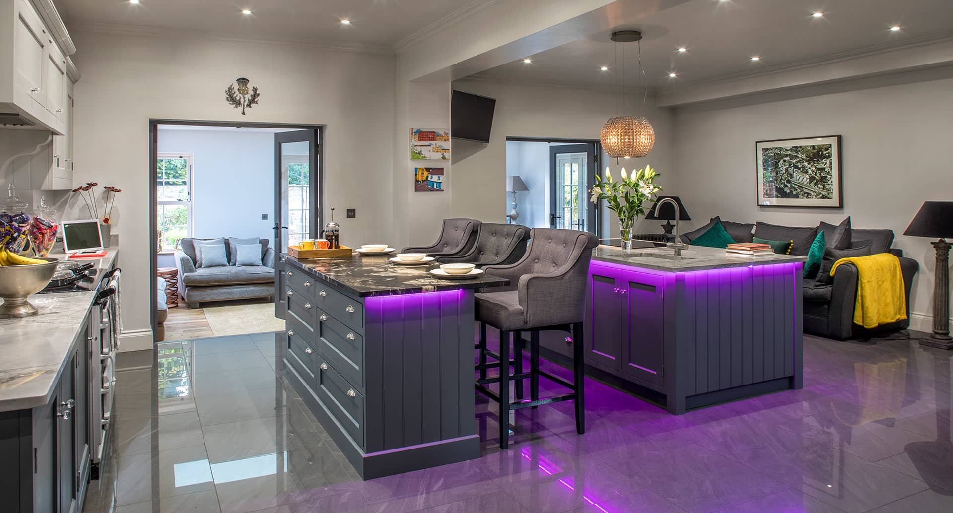 A beautiful, bespoke, fitted kitchen with custom LED lighting under the worktops.