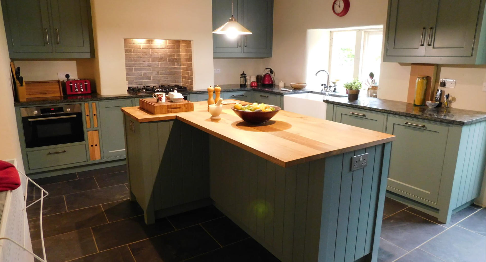 A wide view of a beautiful fitted kitchen.