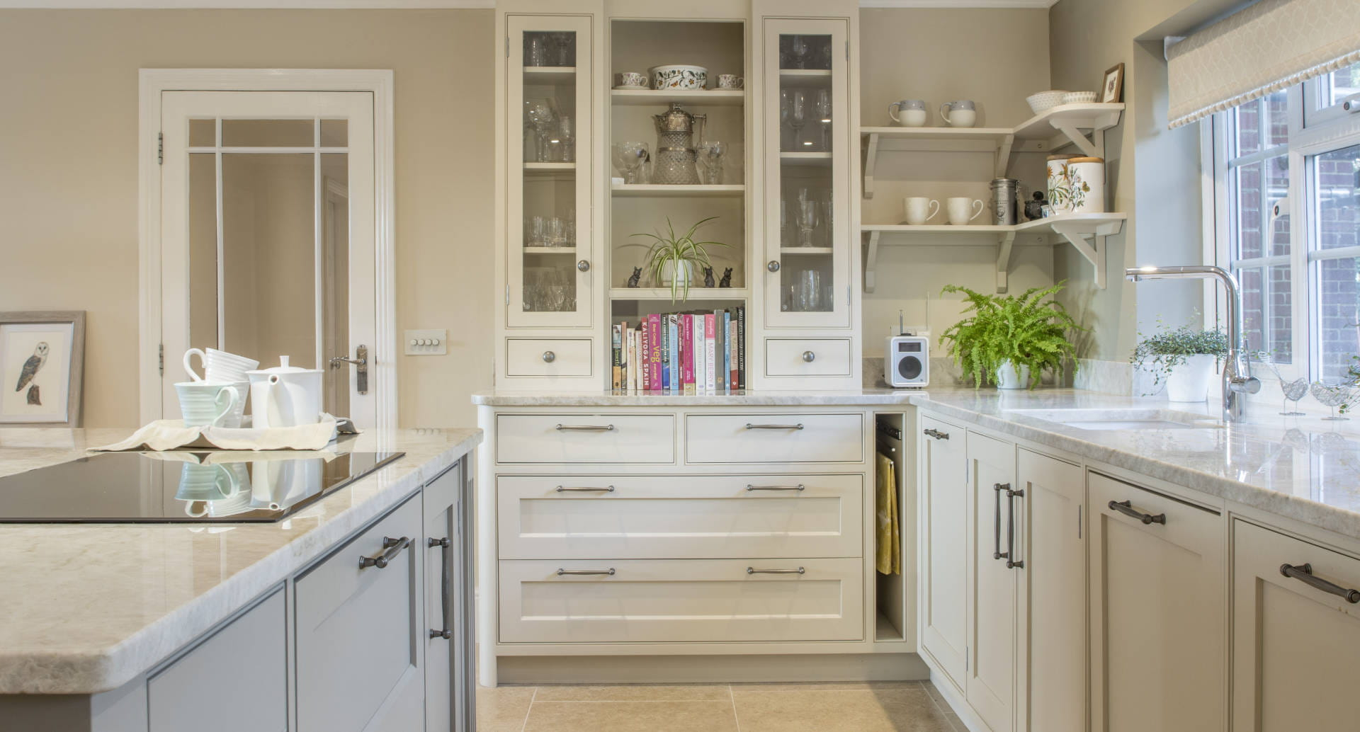 A kitchen side unit with surrounding counter tops.