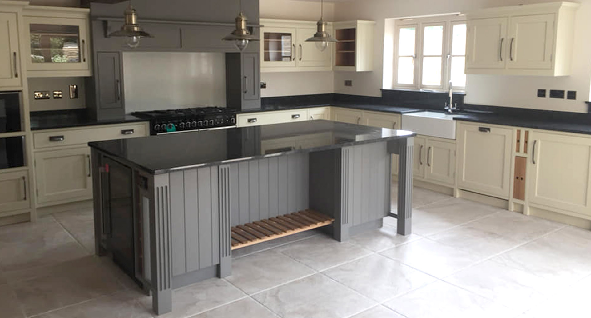 Light kitchen with dark counters and island