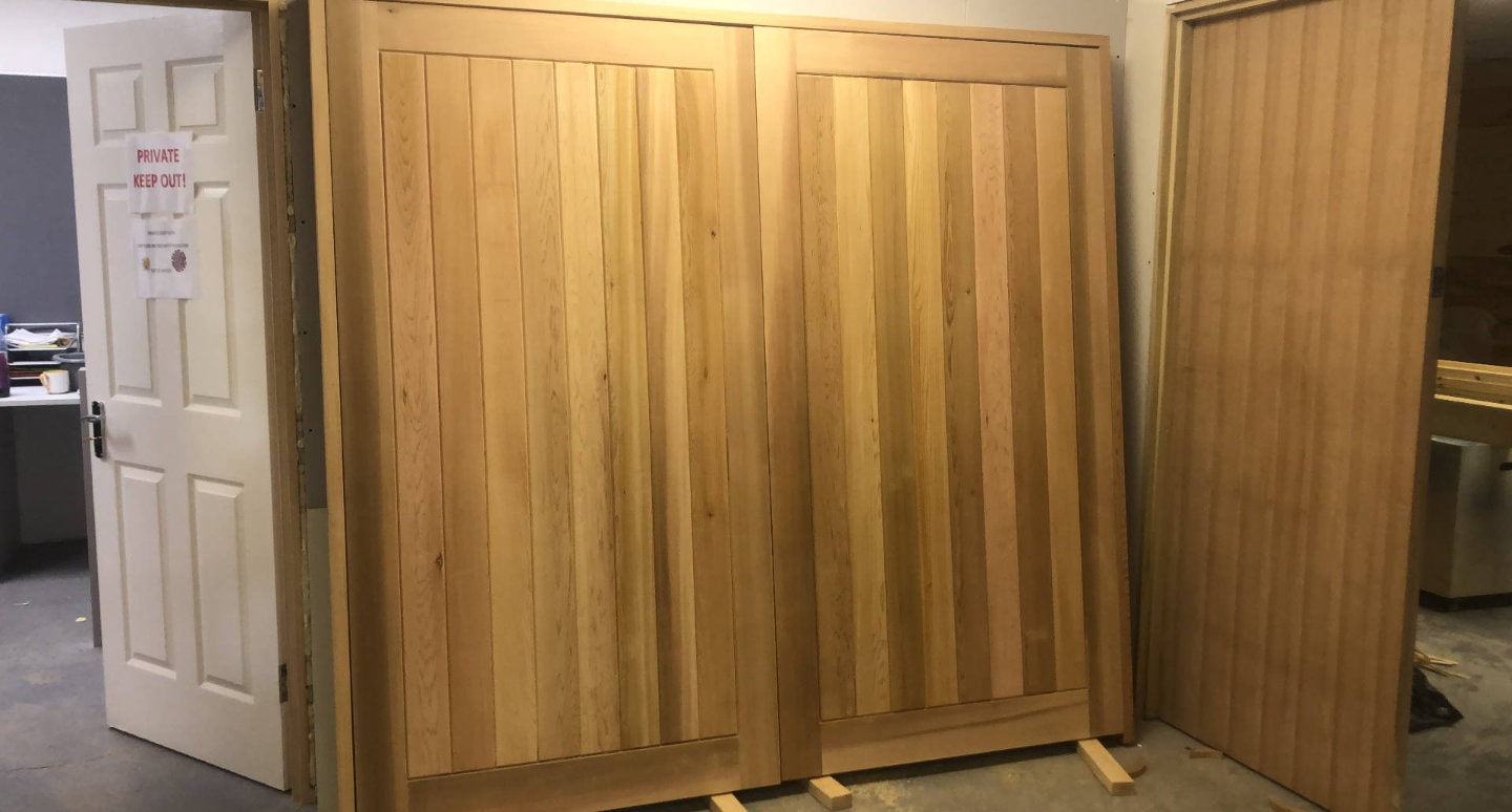 Beautiful handcrafted wooden doors, ready to be hung on a workshop