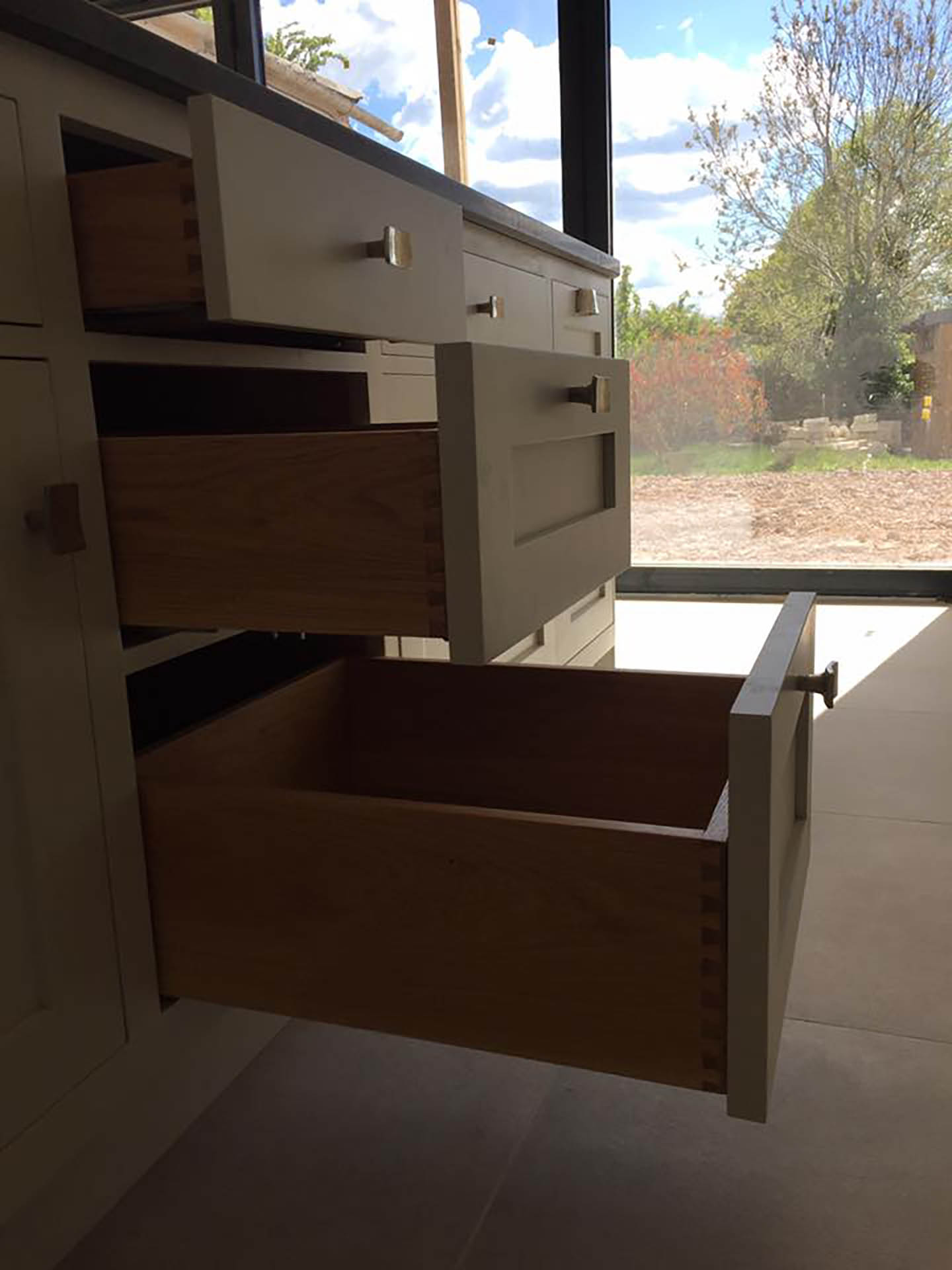 Some open drawers for storing kitchen utensils in