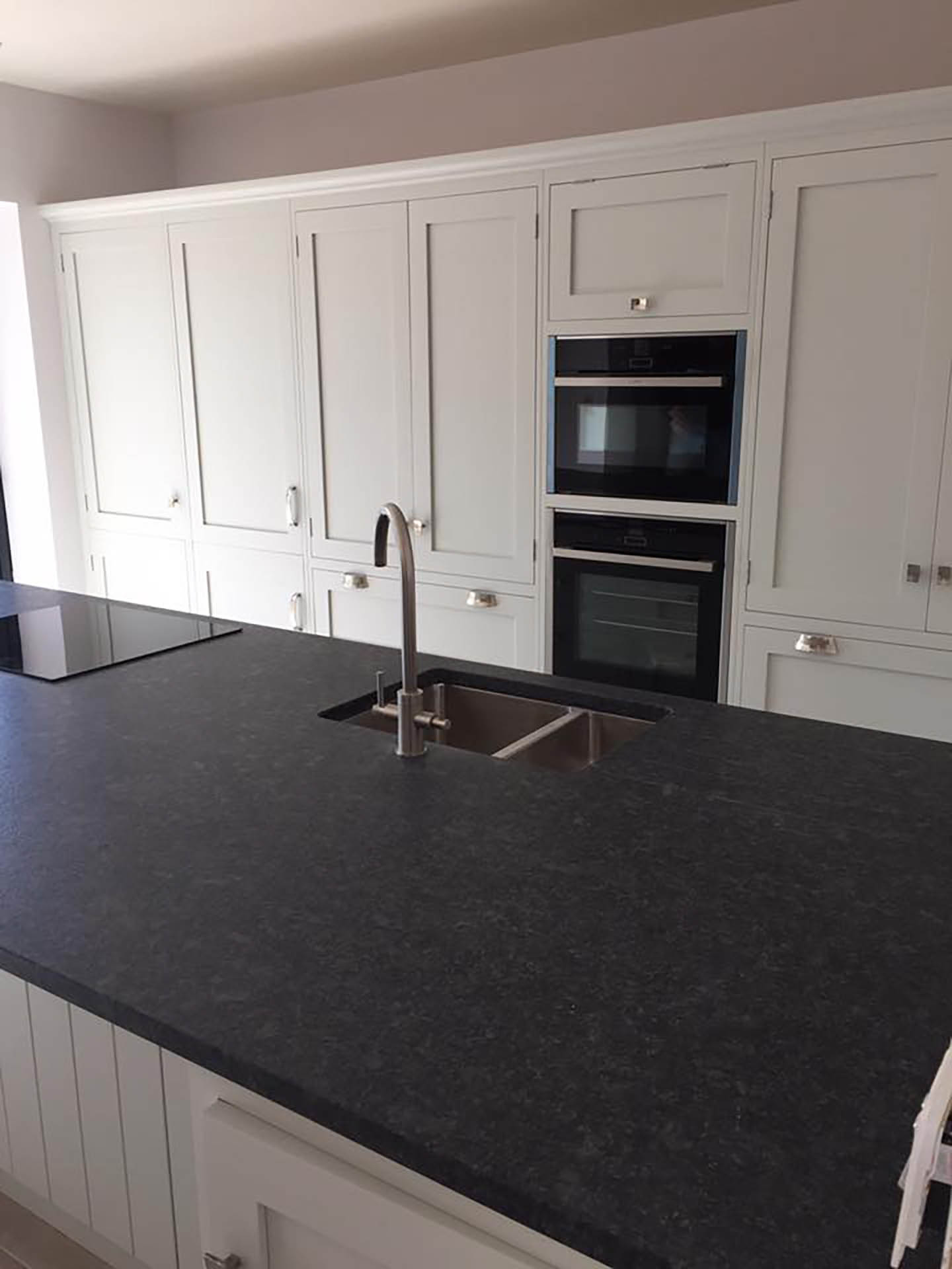 A large, granite topped kitchen surface.