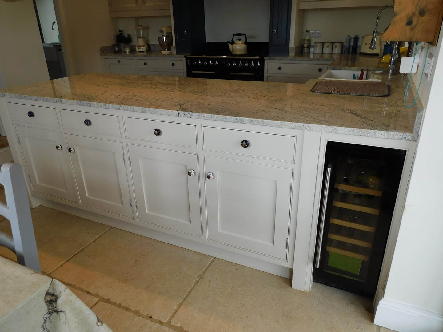 Some kitchen cupboards with a slide-out rack.