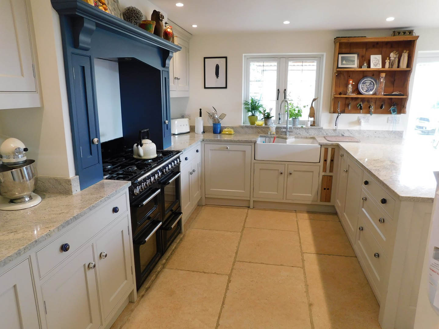 A wide view of a bespoke fitted kitchen